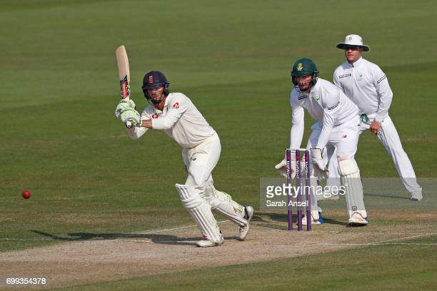 Ben Foakes of the England Lions hits out as South Africa A wicket keeper Heinrich Klaasen and slip fielder Heino Kuhn look on during day 1 of the...
