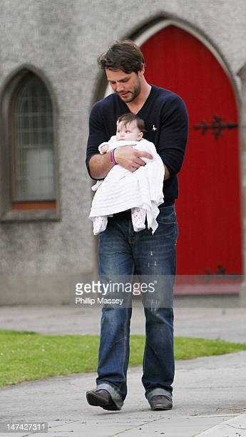 Ben Foden and his daughter Aoife leave a local church after attending a rehearsal of his wedding to Una Healy on June 29 2012 in Tipperary Ireland