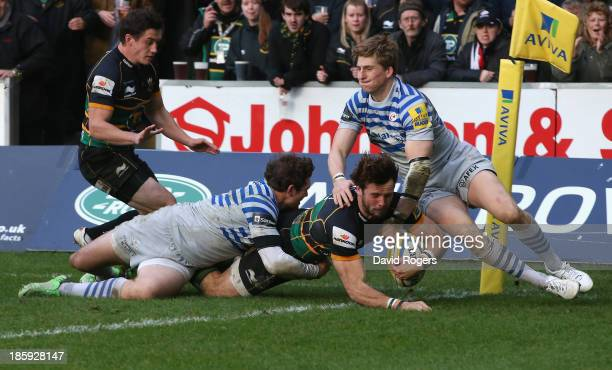 Ben Foden dives over to score the fourth try for Northampton during the Aviva Premiership match between Northampton Saints and Saracens at Franklin's...