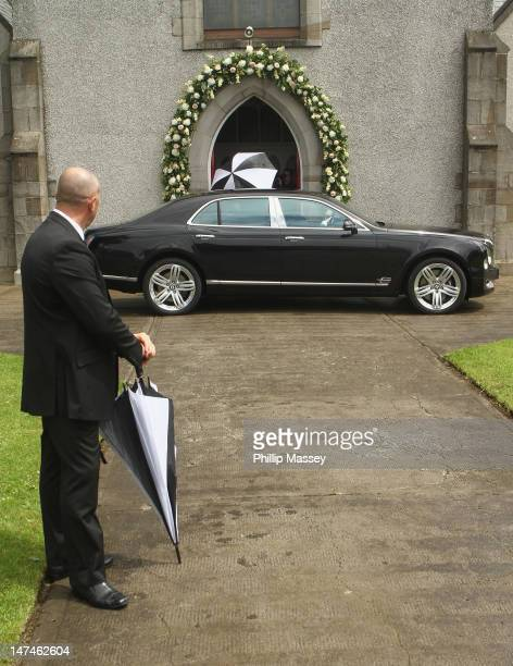 Ben Foden is shielded from photographers as he arrives at his wedding at Bansha Church on June 30 2012 in Tipperary Ireland