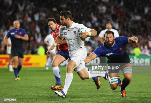 Ben Foden of England breaks past Lionel Nallet of France to score his try during quarter final two of the 2011 IRB Rugby World Cup between England...