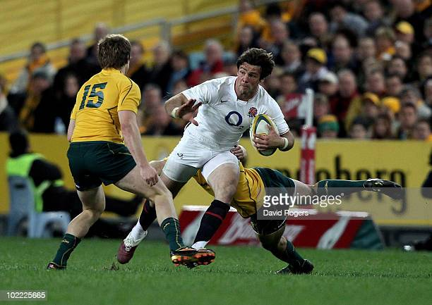 Ben Foden of England takes on James O'Connor during the Cook Cup Test Match between the Australian Wallabies and England at ANZ Stadium on June 19...
