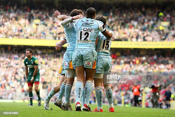Ben Foden of Northampton celebrates with teammates after scoring his team's second try during the Aviva Premiership Final between Leicester Tigers...