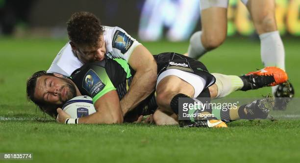 Ben Foden of Northampton is tackled by Duncan Taylor during the European Rugby Champions Cup match between Northampton Saints and Saracens at...