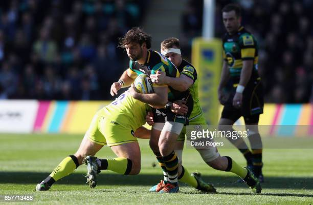 Ben Foden of Northampton is tackled by Tom Youngs and Brendon O'Connor during the Aviva Premiership match between Northampton Saints and Leicester...