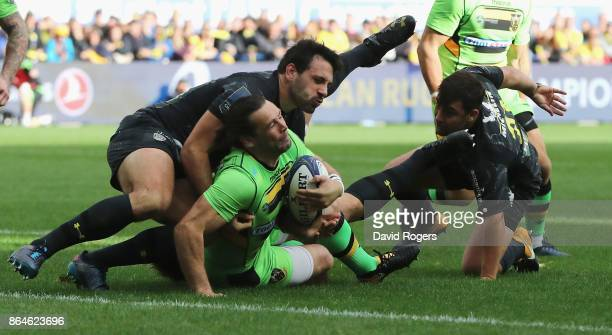 Ben Foden of Northampton is tackled short of the try line by Remi Lamerat during the European Rugby Champions Cup match between ASM Clermont Auvergne...