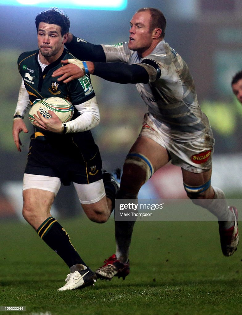 <a gi-track='captionPersonalityLinkClicked' href=/galleries/search?phrase=Ben+Foden&family=editorial&specificpeople=542798 ng-click='$event.stopPropagation()'>Ben Foden</a> of Northampton Saints competes with Jannie Bornman of Castres Olympique during the Heineken Cup match between Northampton Saints and Castres Olympique at Franklin's Gardens on January 11, 2013 in Northampton, England.