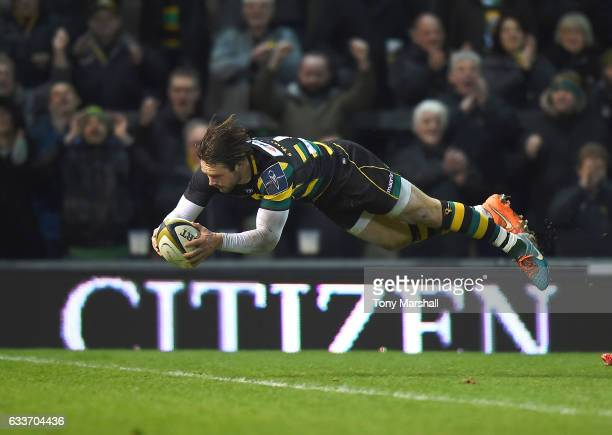 Ben Foden of Northampton Saints dives in to score their third try during the AngloWelsh Cup match between Northampton Saints and Scarlets at...