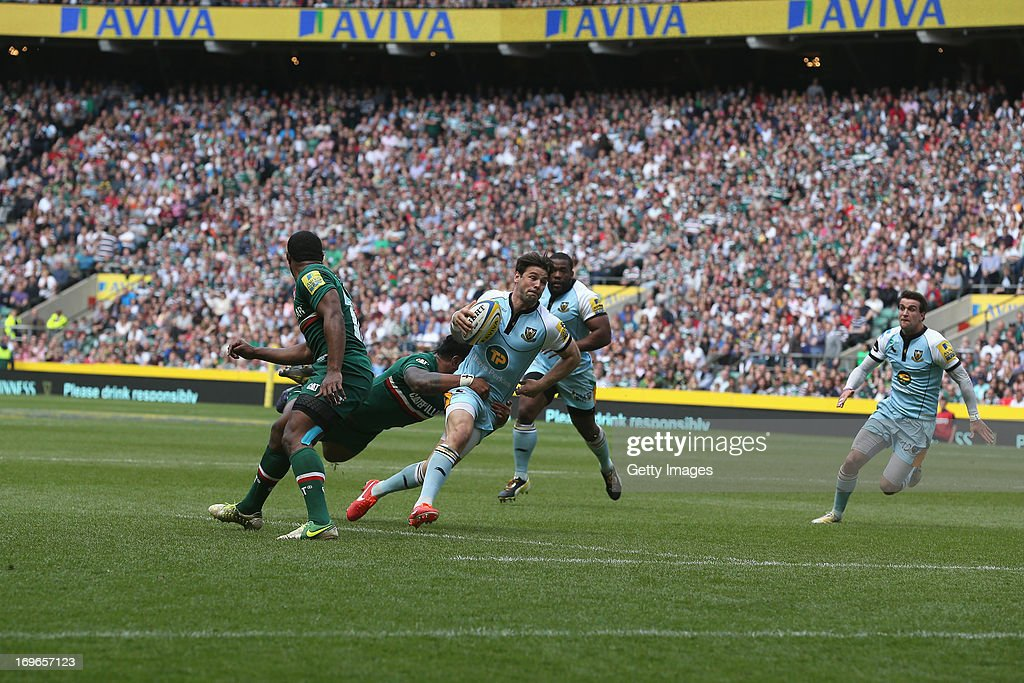 Ben Foden of Northampton Saints makes a break during the Aviva Premiership Final between Leicester Tigers and Northampton Saints at Twickenham Stadium on May 25, 2013 in London, England.