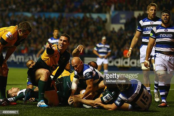 Ben Foden of Northampton touches the ball down for his sides second try during the Amlin Challenge Cup Final between Bath and Northampton Saints at...