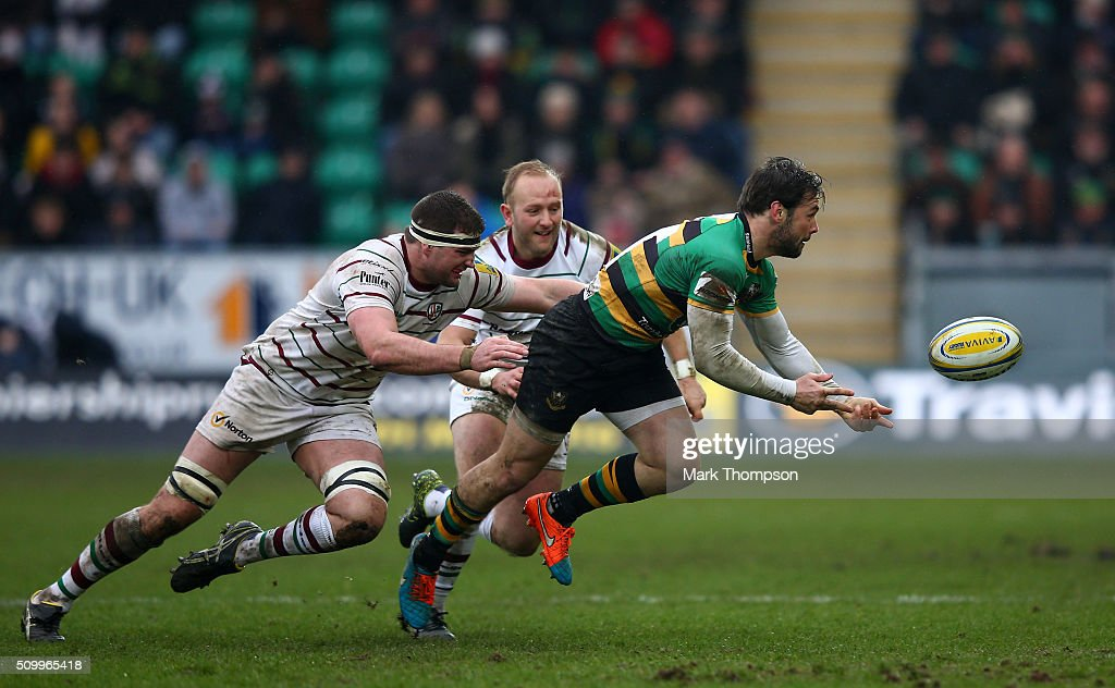 <a gi-track='captionPersonalityLinkClicked' href=/galleries/search?phrase=Ben+Foden&family=editorial&specificpeople=542798 ng-click='$event.stopPropagation()'>Ben Foden</a> of Northamptonoffloads as he is tackled by Matt Symons of London Irish during the Aviva Premiership match between Northampton Saints and London Irish at Franklins Gardens on February 13, 2016 in Northampton, England.