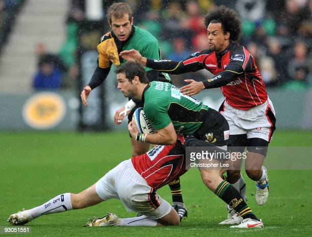 Ben Foden of Saints is tackled by Alex Goode of Saracens during the LV= Cup match between Northampton Saints and Saracens at Franklin Gardens on...