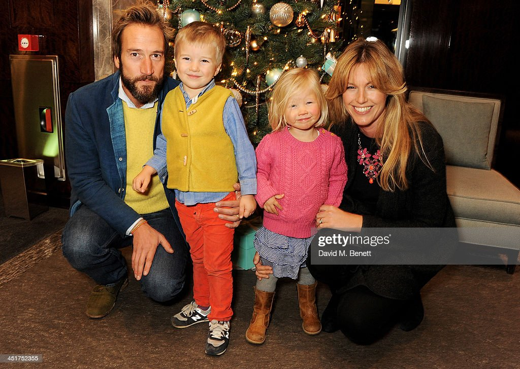 Ben Fogle (L) and wife Marina Fogle (R) with children Ludo and Iona attend as Joely Richardson officially opens the Tiffany & Co. Christmas Shop on Bond Street, London on November 24, 2013 in London, England.