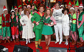 Ben Forster and Kimberley Walsh with the Cast Of 'Elf' unveil Hamleys Christmas windows at Hamleys on November 5 2015 in London England