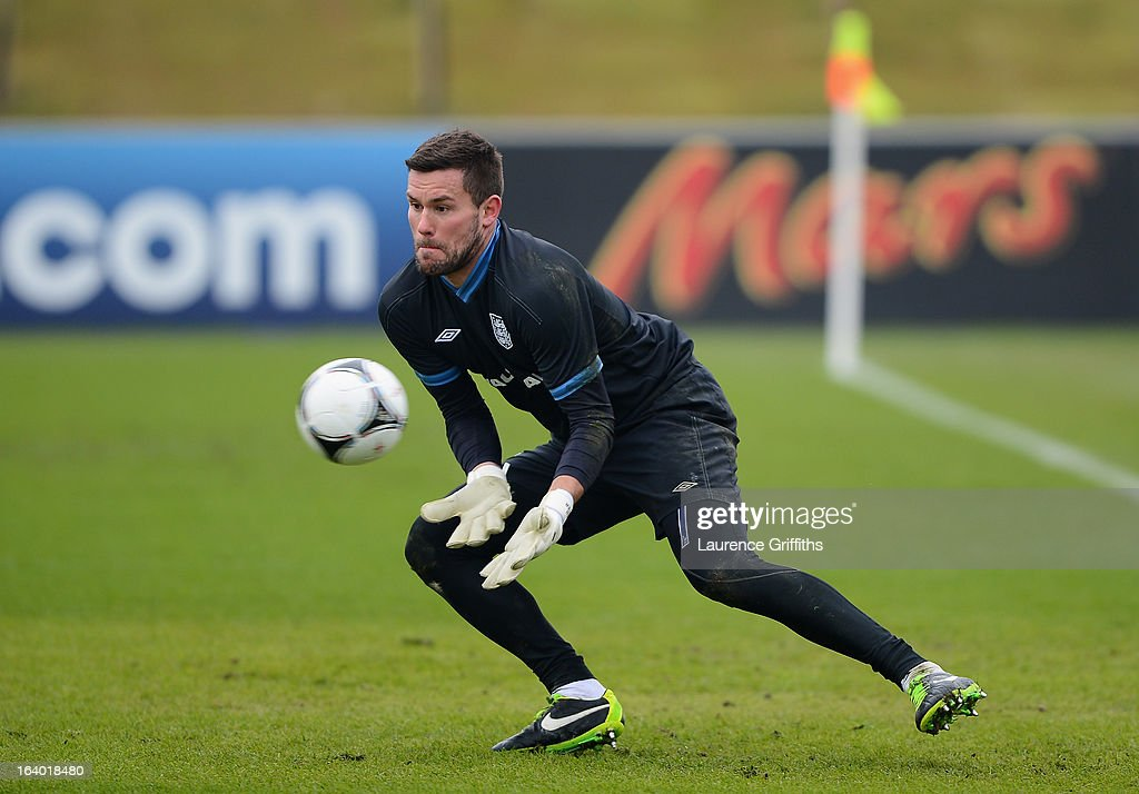 Ben Foster of England makes a save during a training session at St Georges Park on March 19, 2013 in Burton-upon-Trent, England.