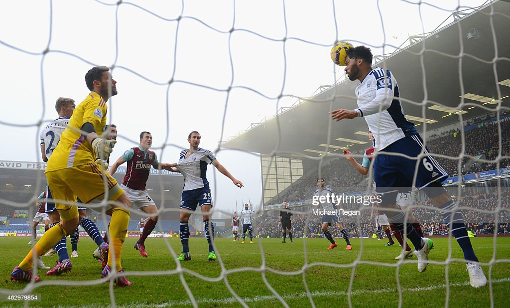 Ben Foster of West Brom looks on as Joleon Lescott of West Brom clears the ball off the line during the Barclays Premier League match between Burnley...