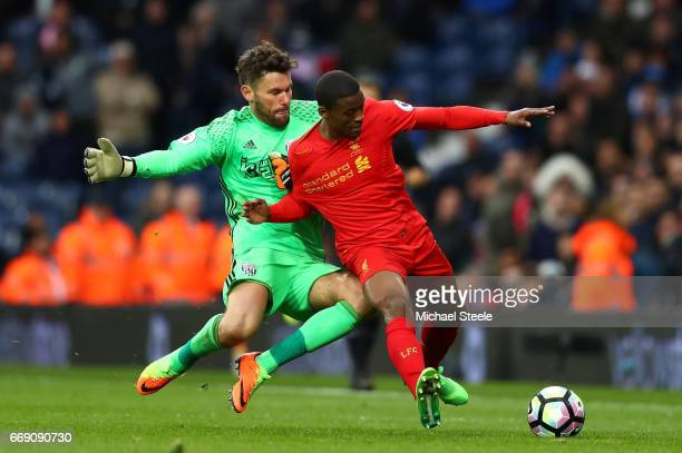 Ben Foster of West Bromwich Albion and Georginio Wijnaldum of Liverpool battle for possession during the Premier League match between West Bromwich...