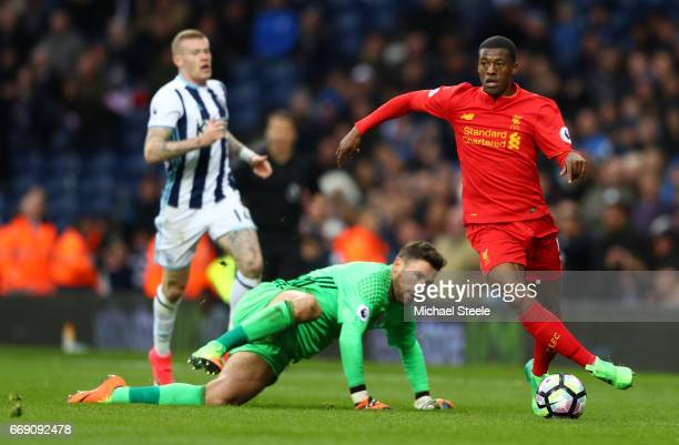 Ben Foster of West Bromwich Albion attempts to tackle Georginio Wijnaldum of Liverpool during the Premier League match between West Bromwich Albion...