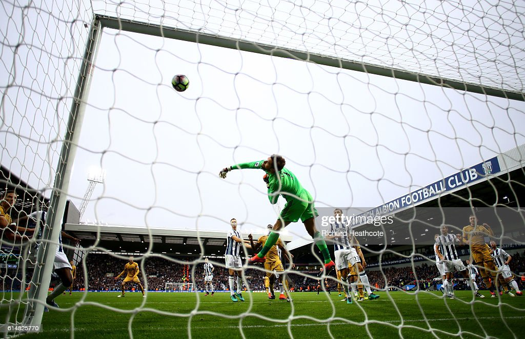 Ben Foster of West Bromwich Albion (C) saves a show from Christian Eriksen of Tottenham Hotspur during the Premier League match between West Bromwich Albion and Tottenham Hotspur at The Hawthorns on October 15, 2016 in West Bromwich, England.