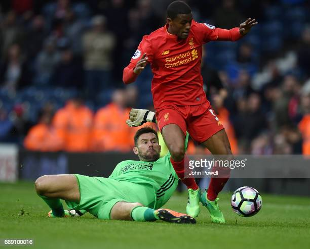 Ben Foster of West Bromwich Albion tries to bring down Georginio Wijnaldum of Liverpool during the Premier League match between West Bromwich Albion...