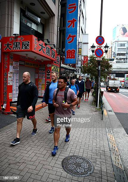 Ben Franks and Keven Mealamu of the All Blacks walk to a pool recovery session on October 29 2013 in Tokyo Japan