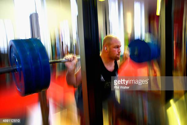 Ben Franks of the All Blacks lifts weights during a New Zealand All Blacks Gym session at the Cardiff University Strength and Conditioning Centre on...