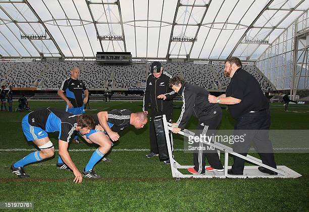 Ben Franks of the All Blacks looks on as Sam Whitelock and Tony Woodcock of the All Blacks practice the scrum during a New Zealand All Blacks...