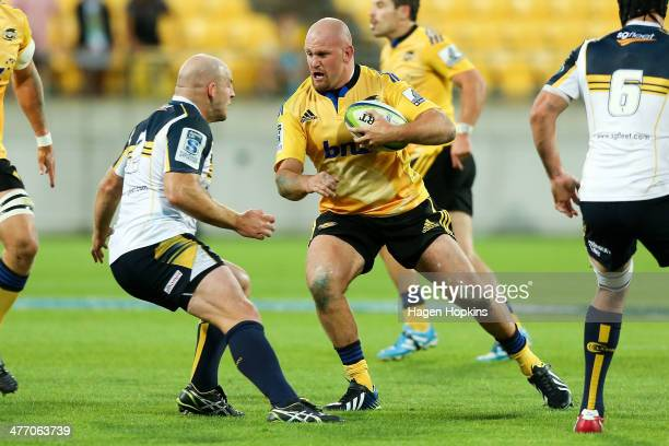 Ben Franks of the Hurricanes runs into the defence of Stephen Moore of the Brumbies during the round four Super Rugby match between the Hurricanes...