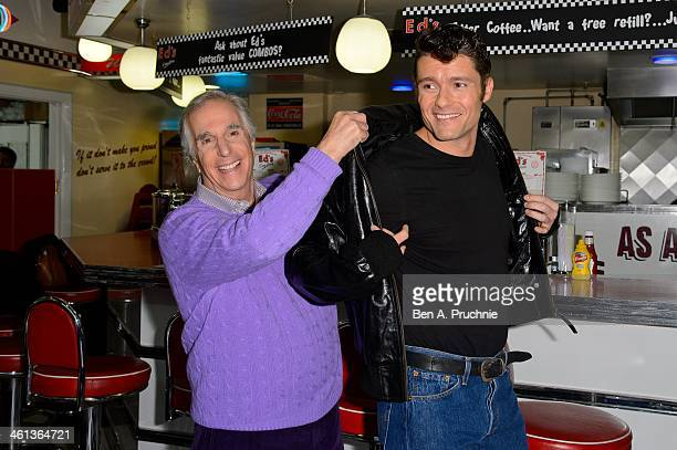 Ben Freeman and Henry Winkler attend a photocall for new musical 'Happy Days' at Ed's Easy Diner on January 8 2014 in London England