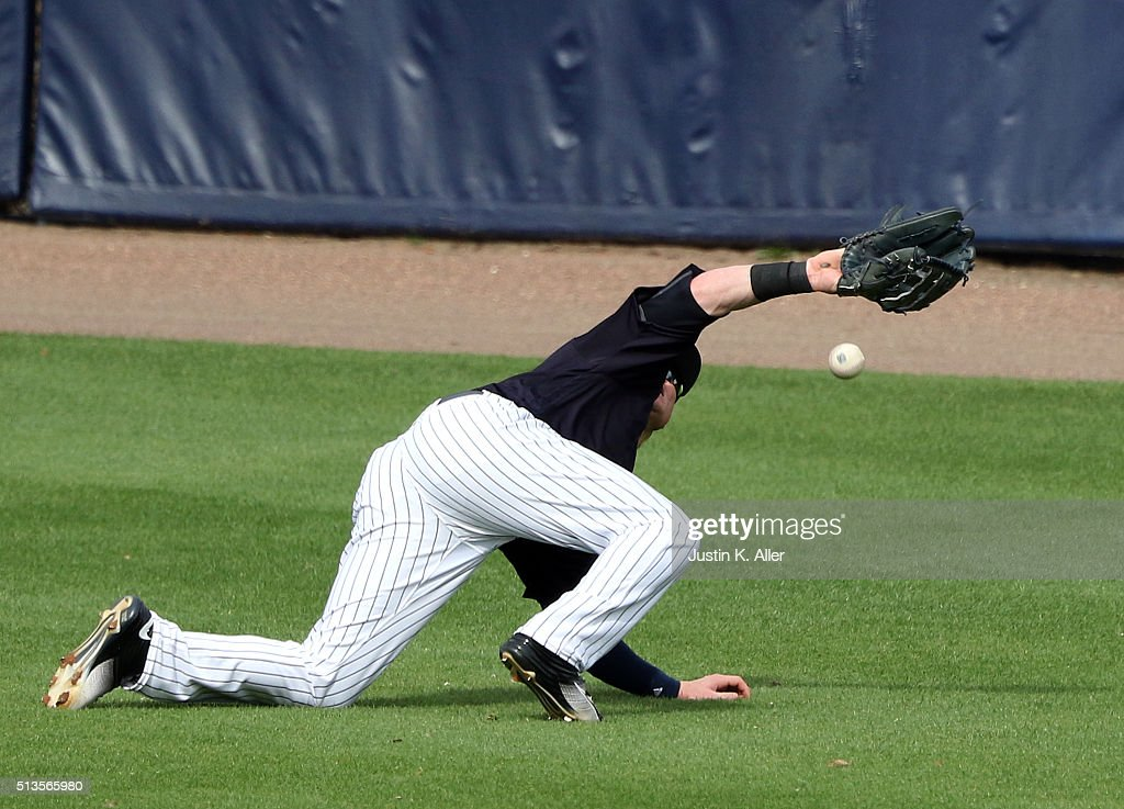 Ben Gamel #82 of the New York Yankees loses the ball in the sun in the seventh inning during the game against the Philadelphia Phillies at George M. Steinbrenner Field on March 3, 2016 in Clearwater, Florida.
