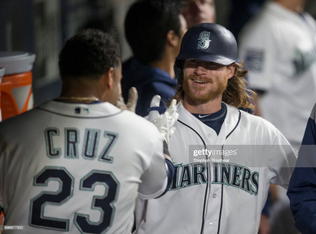 Ben Gamel #16 of the Seattle Mariners is congratulated by Nelson Cruz #23 of the Seattle Mariners after hitting a solo home run off of starting pitcher Jordan Zimmermann #27 of the Detroit Tigers during the seventh inning of a game at Safeco Field on June 20, 2017 in Seattle, Washington.