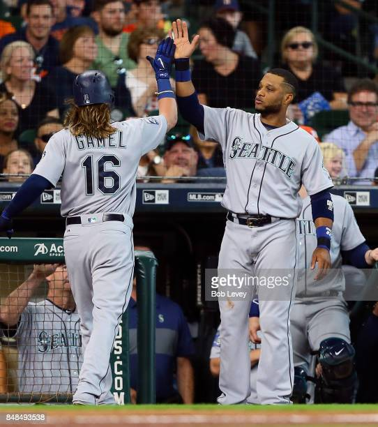 Ben Gamel of the Seattle Mariners receives a high five from Robinson Cano after hitting a home run in the third inning against the Houston Astros at...