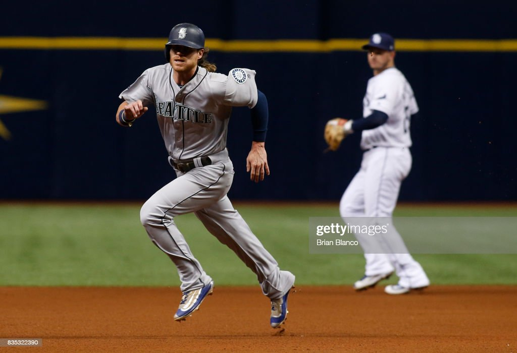 Ben Gamel #16 of the Seattle Mariners sprints toward third base as he advances off of the double by Guillermo Heredia during the fourth inning of a game against the Tampa Bay Rays on August 18, 2017 at Tropicana Field in St. Petersburg, Florida.