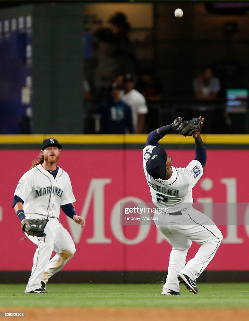 Ben Gamel #16 of the Seattle Mariners watches as Jean Segura #2 of the Seattle Mariners catches a ball hit by Jorge Bonifacio #38 of the Kansas City Royals in the ninth inning at Safeco Field on July 5, 2017 in Seattle, Washington.