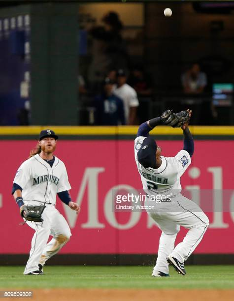 Ben Gamel of the Seattle Mariners watches as Jean Segura of the Seattle Mariners catches a ball hit by Jorge Bonifacio of the Kansas City Royals in...
