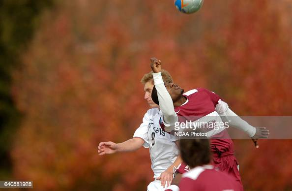 Ben Gantenbein of Fort Lewis and Michael AduGvamfi of Franklin Pierce jump for a header during the Men's Division II Soccer Championship held on the...