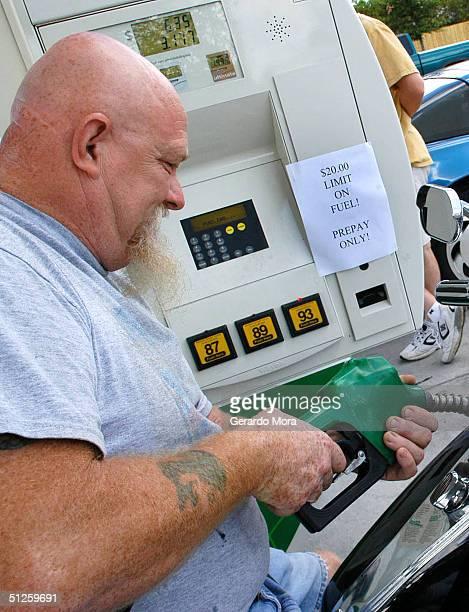 Ben Garrett fills his gas tank in preparation for Hurricane Frances September 3 2004 in Orlando Florida Hurricane Francis a category 3 hurricane is...