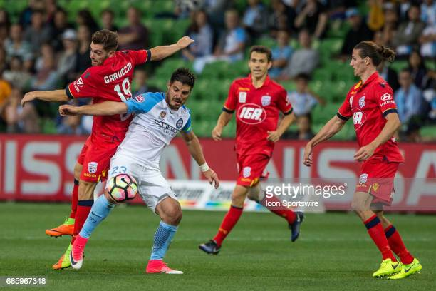 Ben Garuccio of Adelaide United and Bruno Fornaroli of Melbourne City contest the ball during the round 26 match of the Hyundai ALeague between...