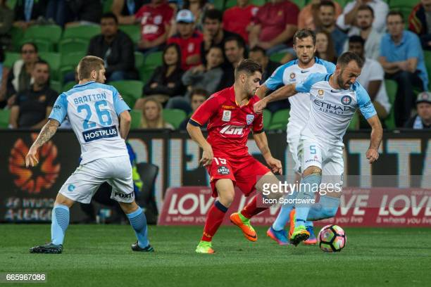 Ben Garuccio of Adelaide United Luke Brattan of Melbourne City and Ivan Franjic of Melbourne City contest the ball during the round 26 match of the...