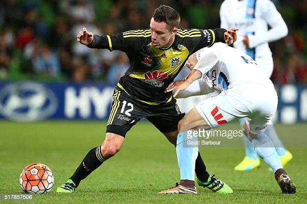 Ben Garuccio of City FC and Blake Powell of the Phoenix compete for the ball during the round 25 ALeague match between Melbourne City FC and the...