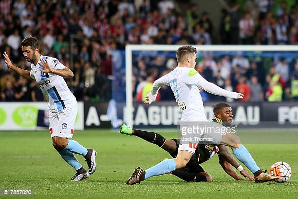 Ben Garuccio of Melbourne City competes for the ball against Rolieny Bonevacia of the Phoenix during the round 25 ALeague match between Melbourne...
