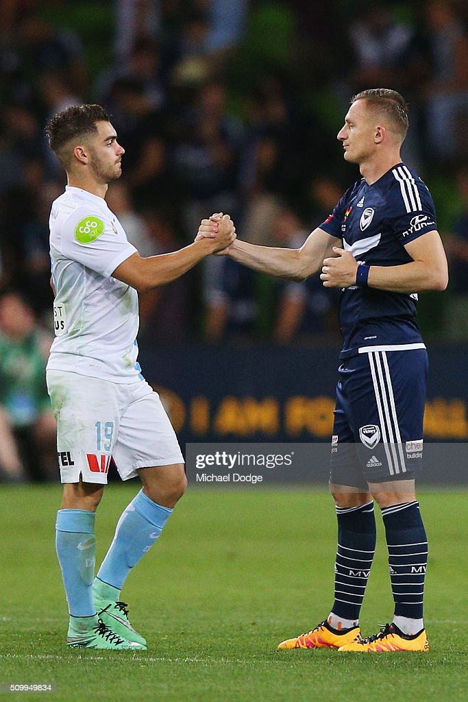 Ben Garuccio of the City (L) and Besart Berisha of the Victory shake hands after the drawn round 19 A-League match between Melbourne City FC and Melbourne Victory at AAMI Park on February 13, 2016 in Melbourne, Australia.