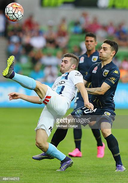 Ben Garuccio of the City kicks the ball away from Anthony Caceres of the Mariners during the round three ALeague match between Melbourne City FC and...