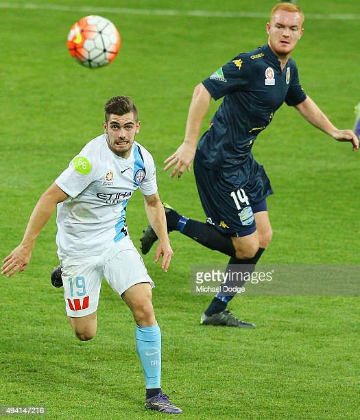 Ben Garuccio of the City runs with the ball during the round three ALeague match between Melbourne City FC and the Central Coast Mariners at AAMI...