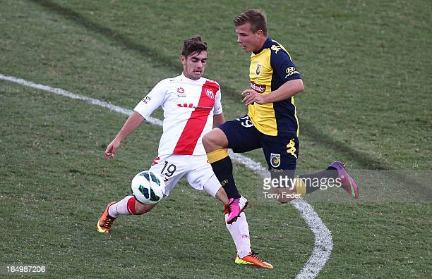 Ben Garuccio of the Heart is challenged by Mitchell Duke of the Mariners during the round 27 ALeague match between the Central Coast Marines and the...