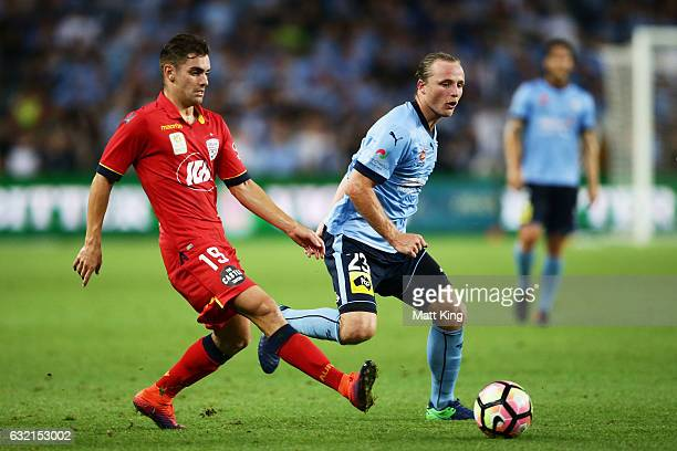 Ben Garuccio of United is challenged by Rhyan Grant of Sydney FC during the round 16 ALeague match between Sydney FC and Adelaide United at Allianz...
