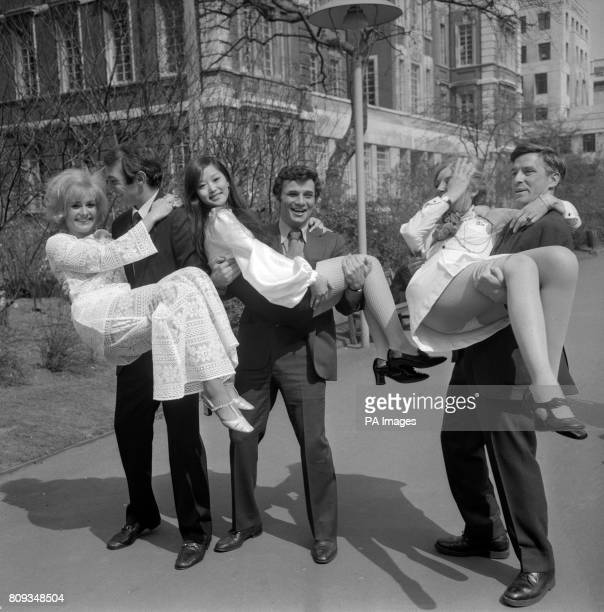 Ben Gazzara carrying Jenny LeeWright Peter Falk carrying Noelle Kao and John Cassavetes carrying Jenny Runacre at the Embankment Gardens London They...