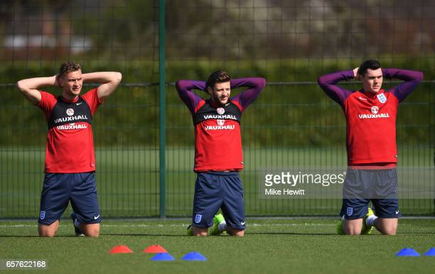 Ben Gibson Adam Lallana and Michael Keane of England run through drills during the England training session at the Tottenham Hotspur Training Centre...