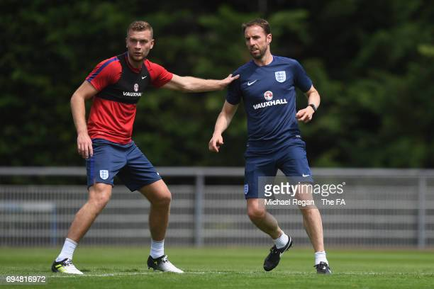 Ben Gibson looks on with England manager Gareth Southgate during the England training session at Stade Omnisports on June 11 2017 in Paris France