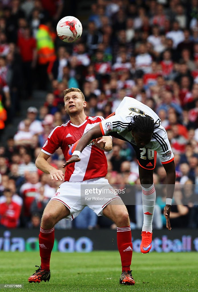 Ben Gibson of Middlesbrough and Hugo Rodallega of Fulham challenge for the ball during the Sky Bet Championship match between Fulham and Middlesbrough at Craven Cottage on April 25, 2015 in London, England.